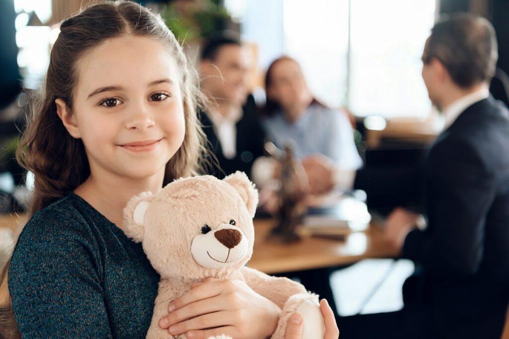 Girl holding stuffed bear