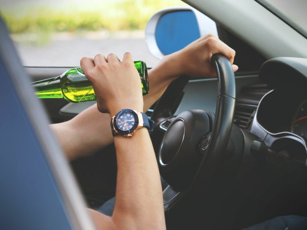 Person Drinking & Driving